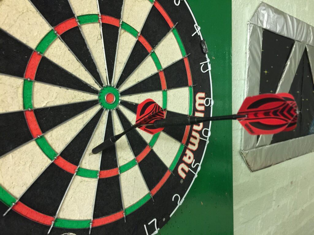 Darts into each other